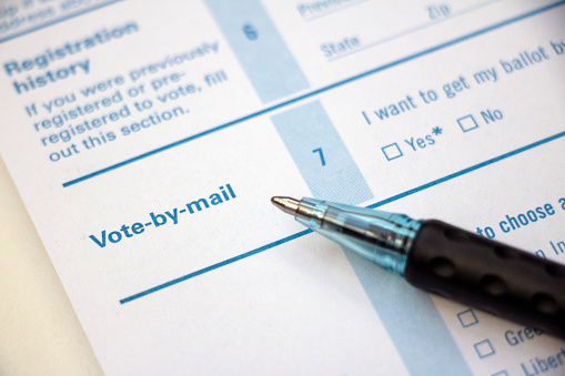 "A picture of a section of a voter registration application that says ""Vote-by-mail"""