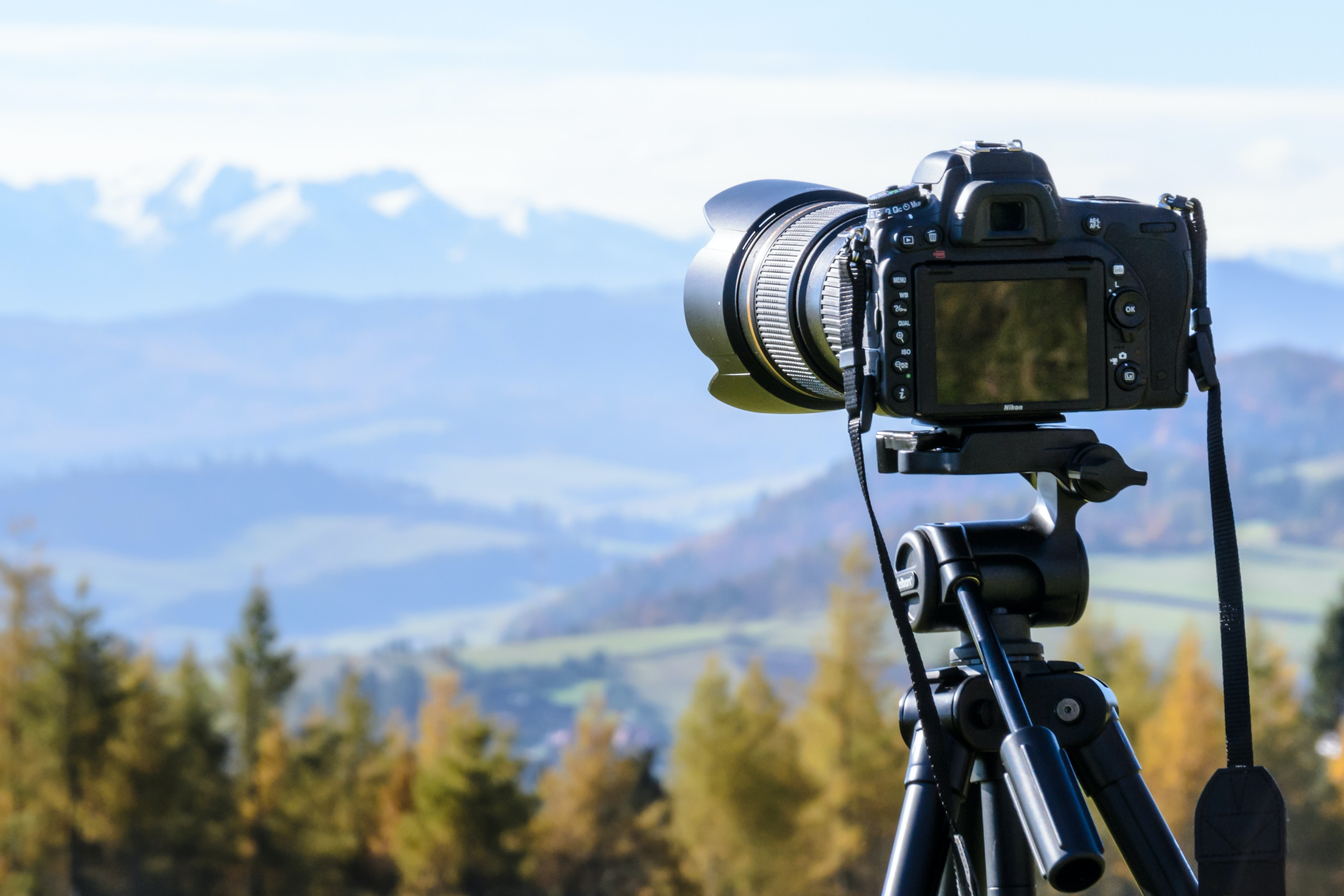 DSLR camera pointed towards landscape