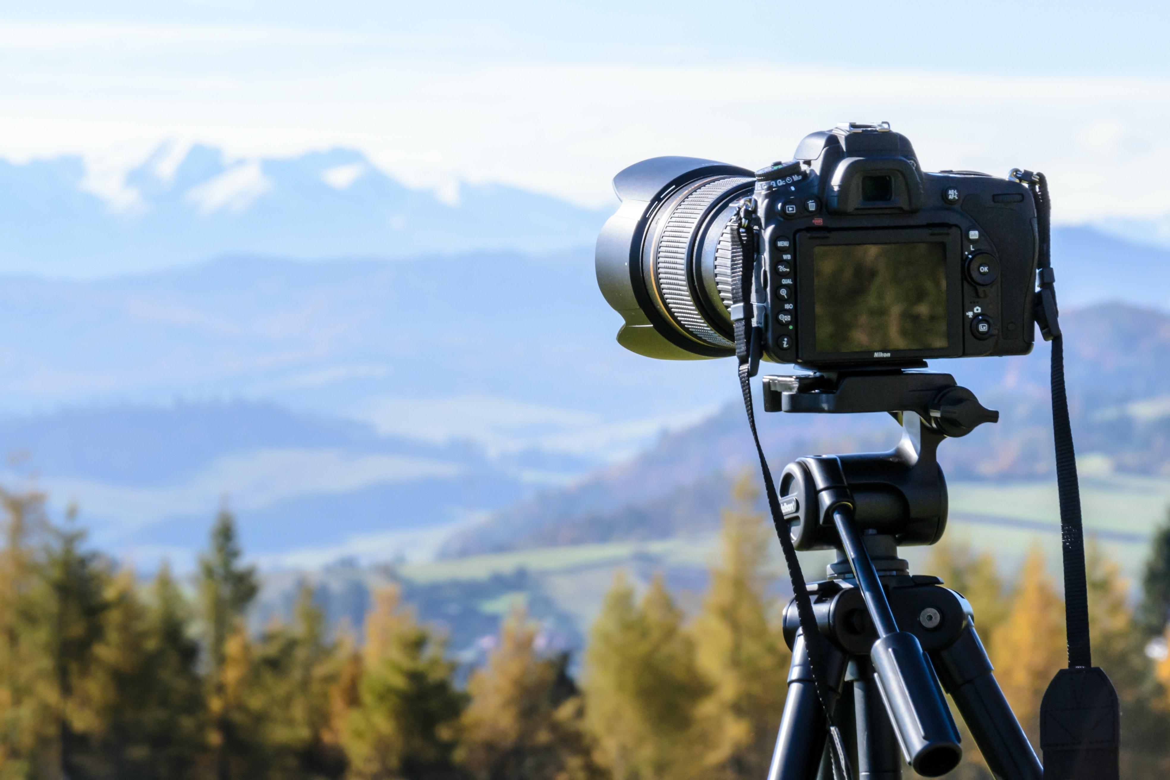 DSLR camera pointed towards landscape