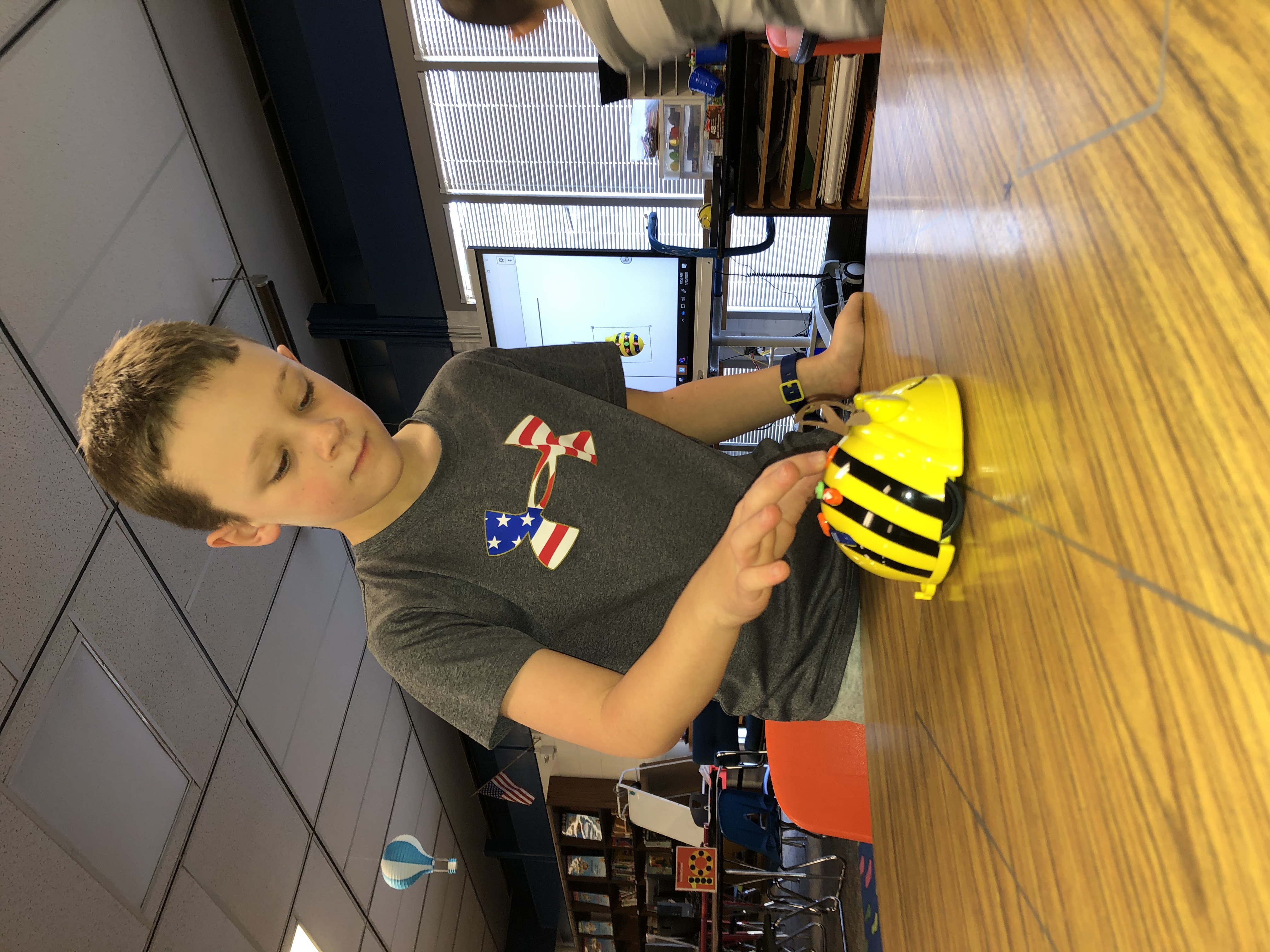 student with beebot image