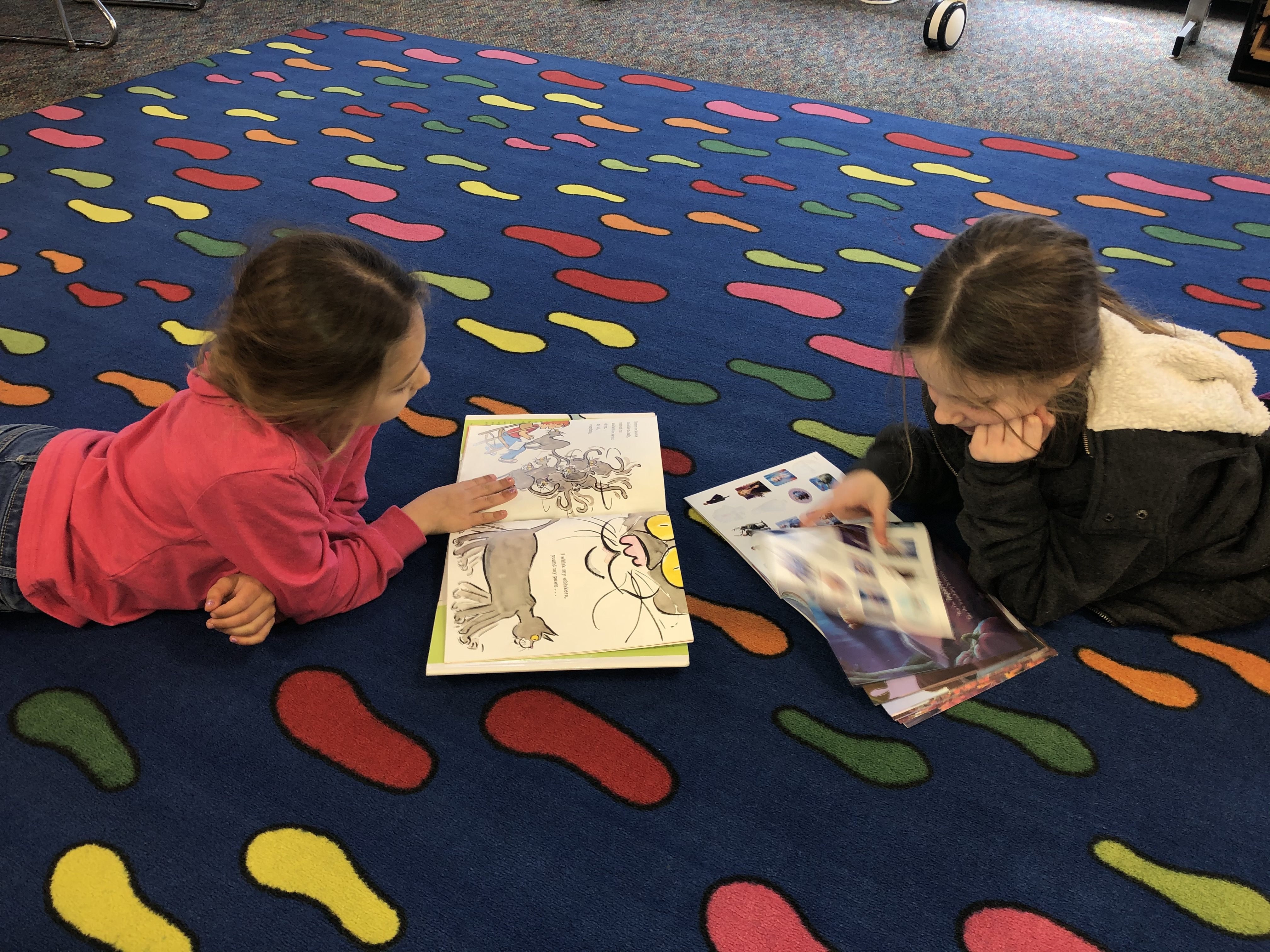 two students reading book