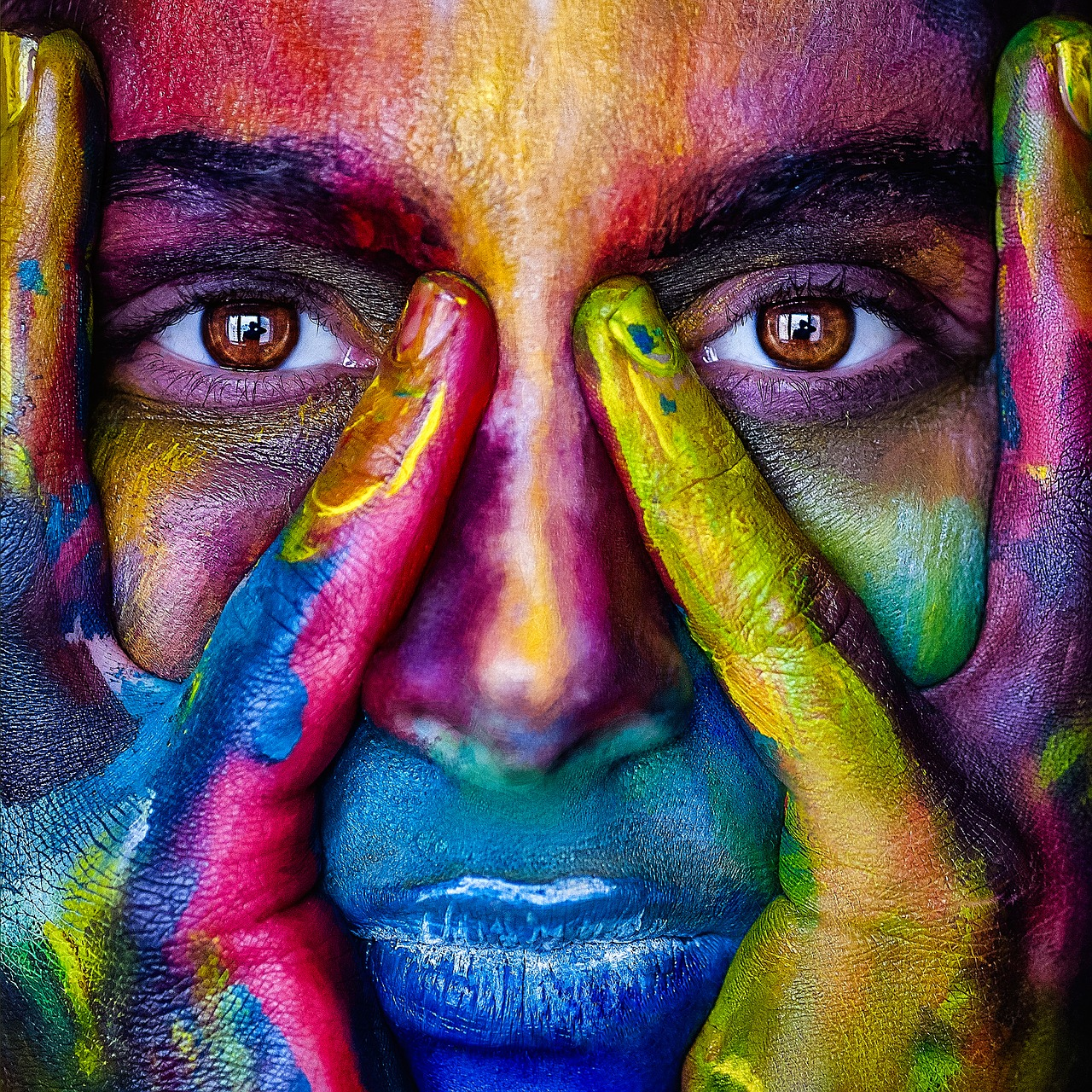 image of human face painted with neon colors