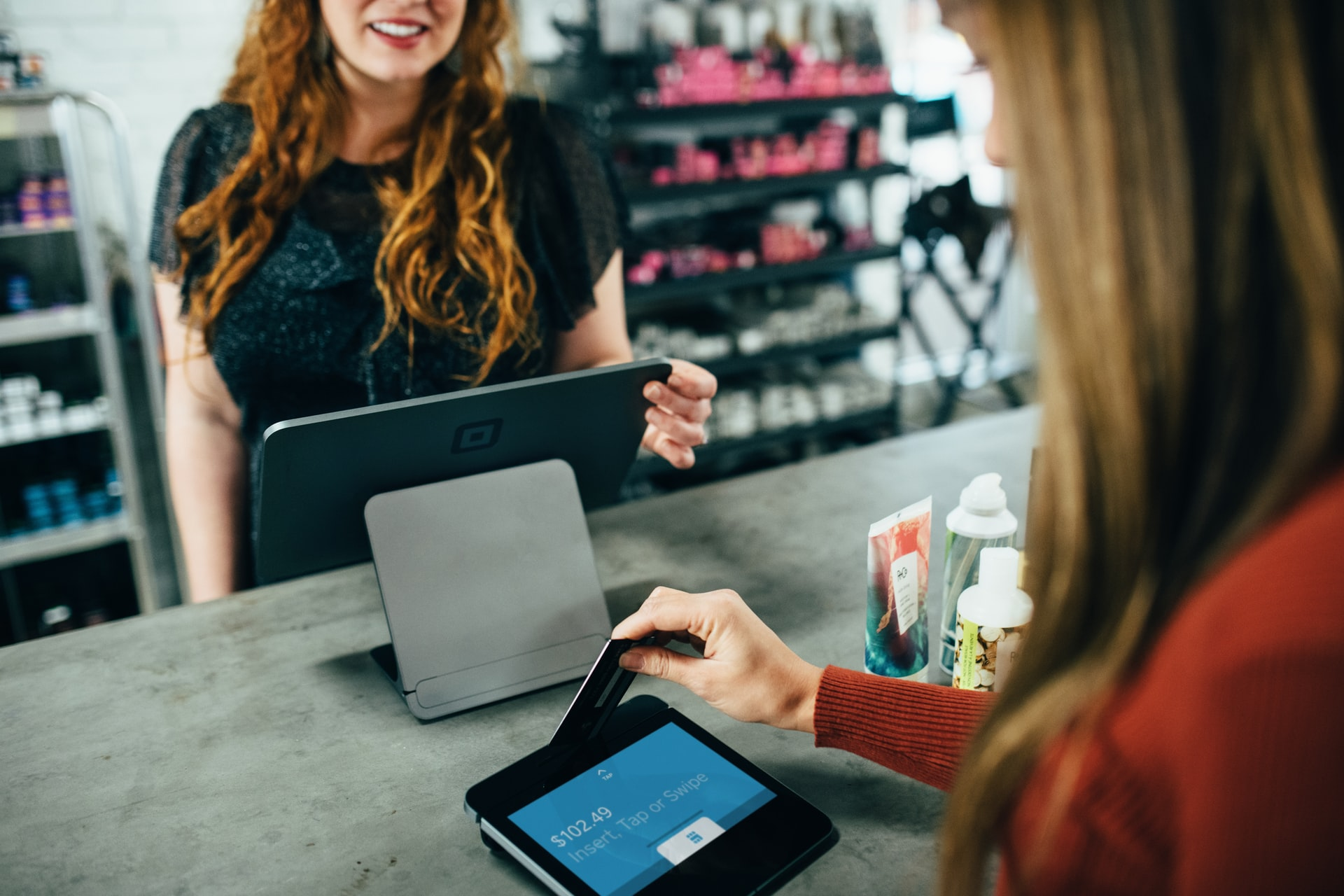 image of shopper paying for beauty products with a credit card machine