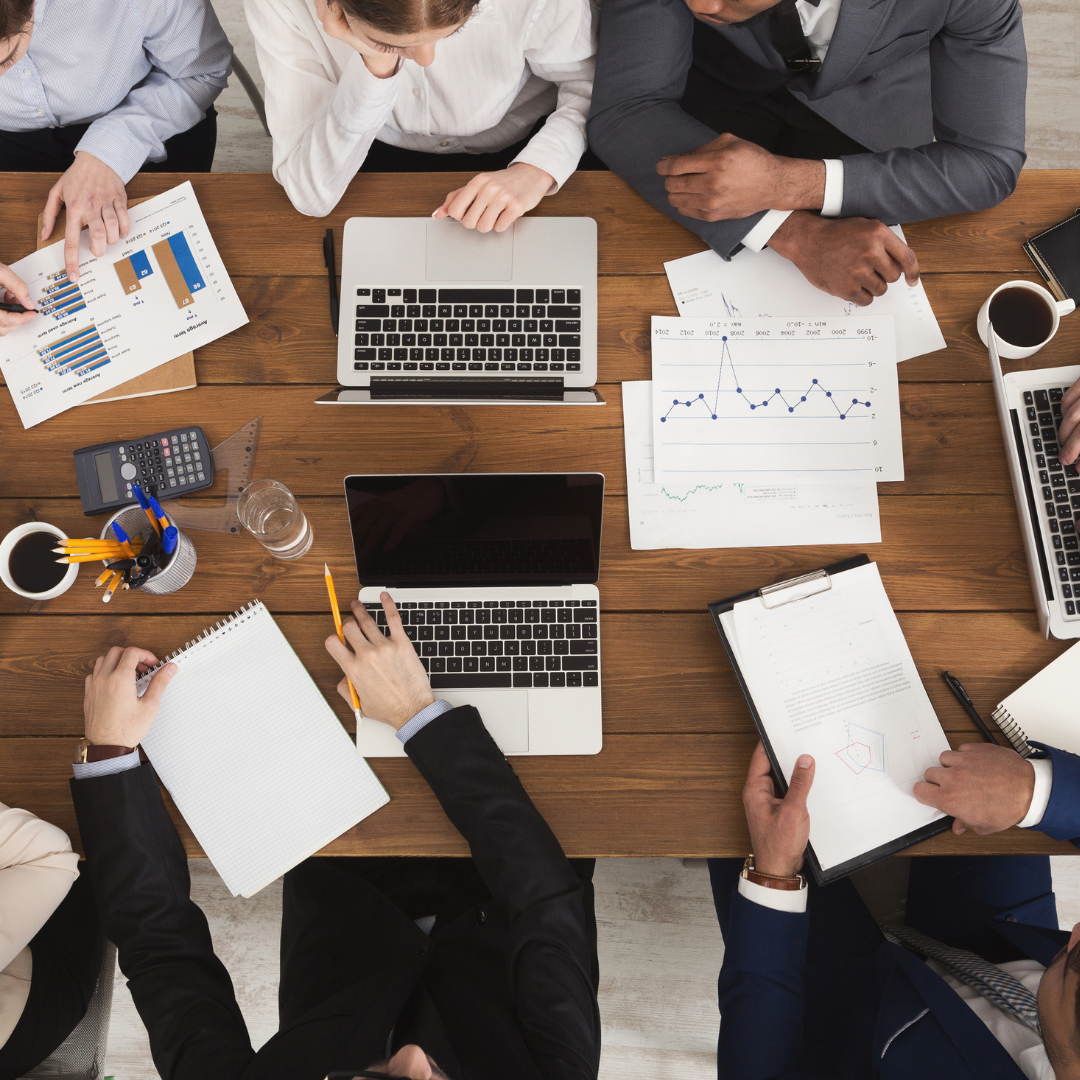 Image of table with people planning over a business project