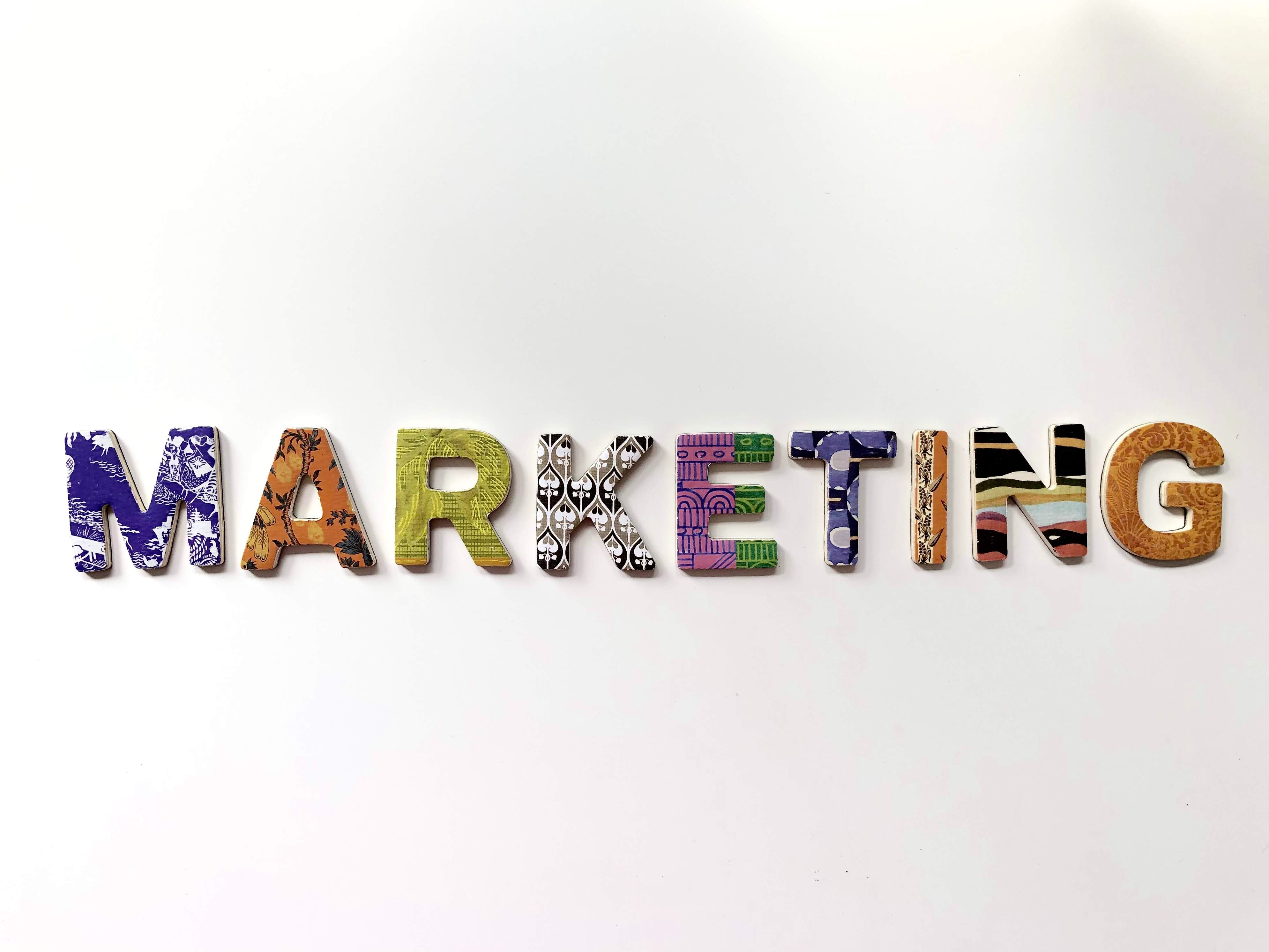 Image of the word marketing spelled using letters made of fabric patterns