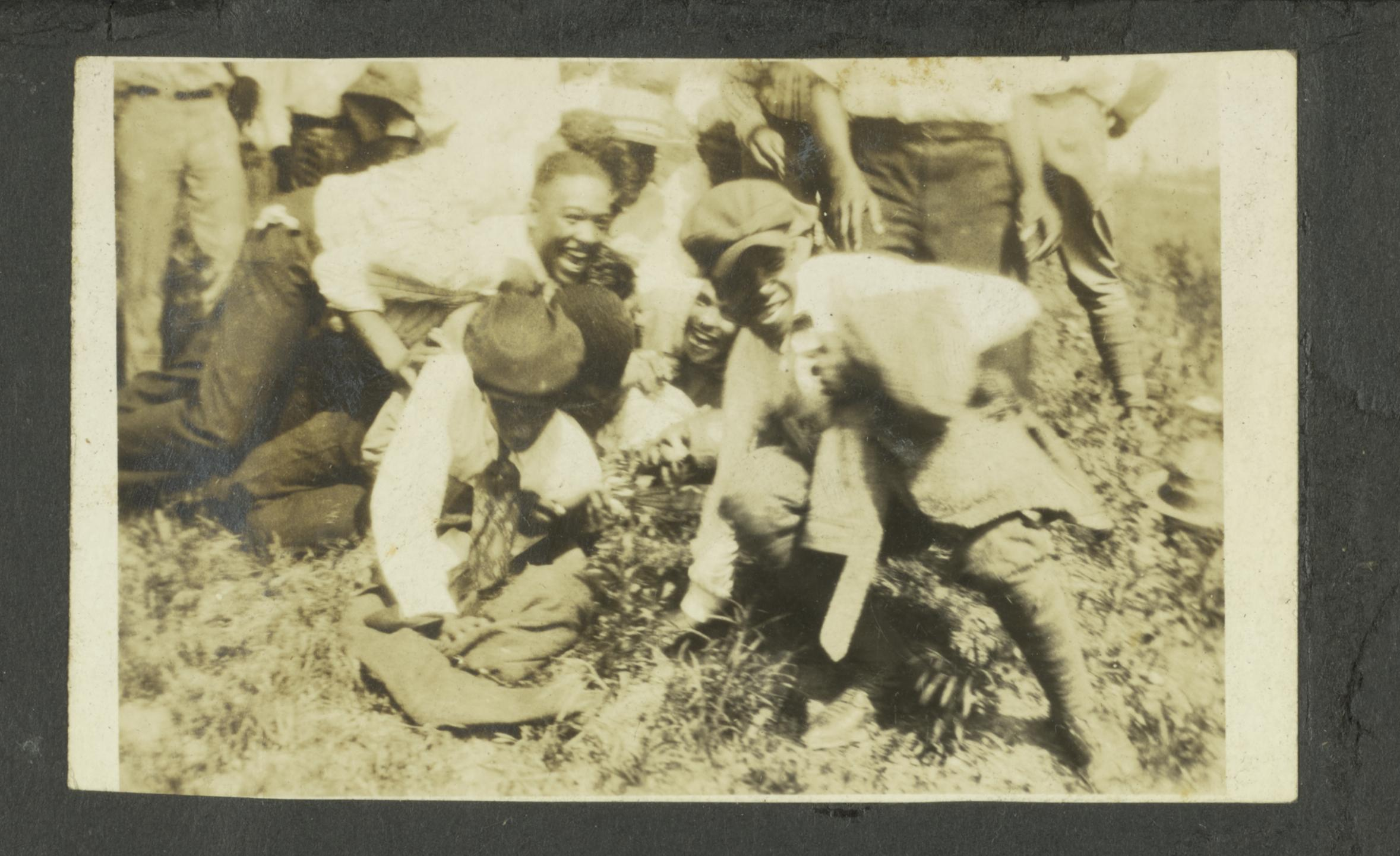 Group of unidentified black men piling on top of each other, undated