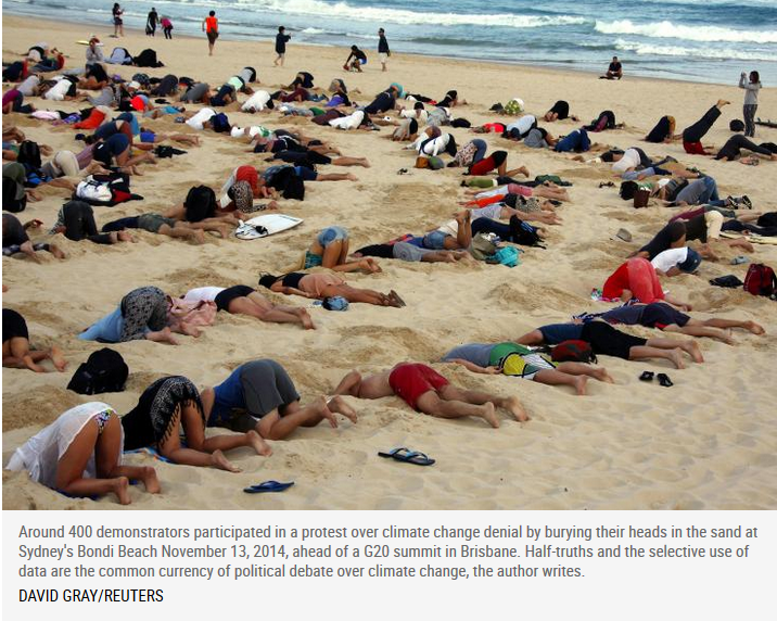 400 protesters with their heads appearing to be buried in the sand.