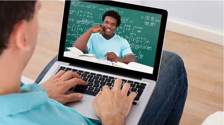 Photo of a student with a laptop learning online