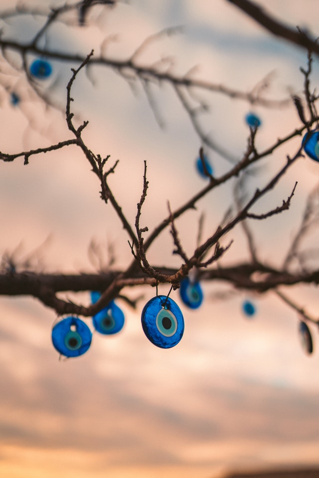 Eye amulets hanging from tree branches