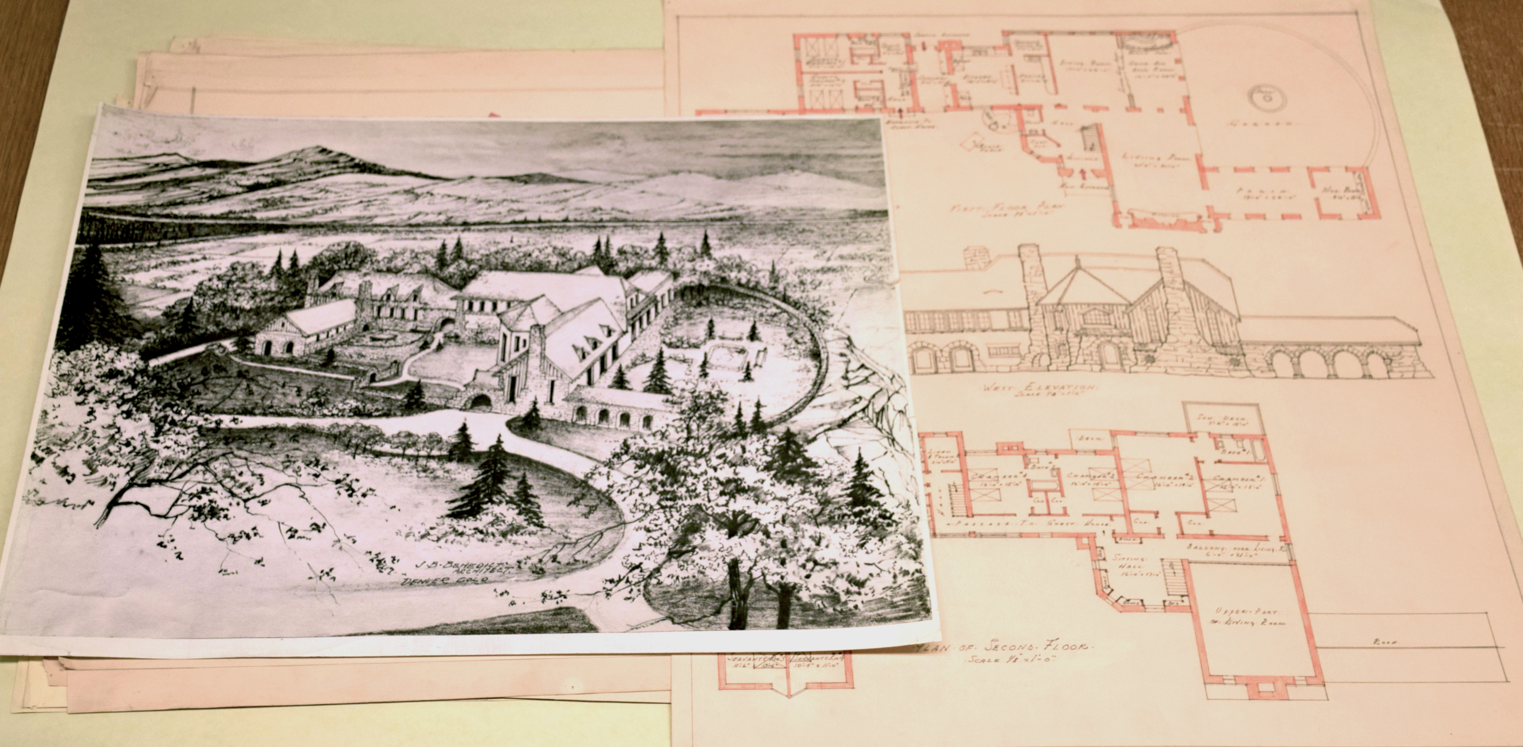 Photograph of architectural plans for a large mountain house
