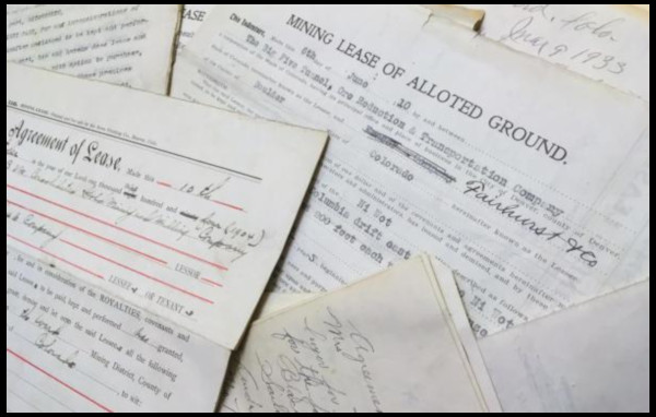 Photograph of paper land lease documents, dated 1910