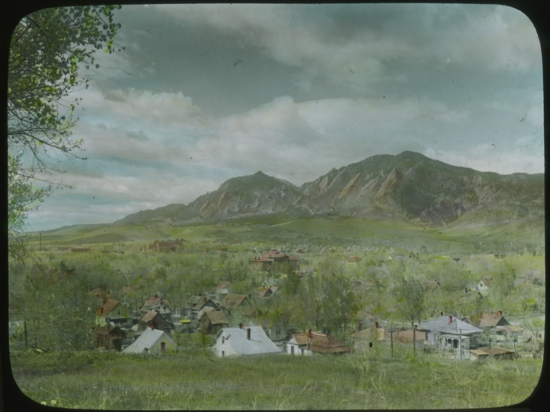 Colorized glass lantern slide showing landscape of Boulder Flat Irons from Sunset Hill