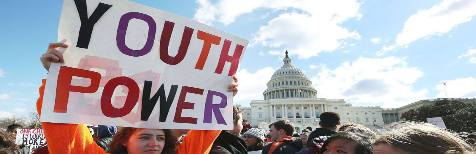 "image of teens protesting in front of the White House holding a sign with the words ""Youth Rights"""