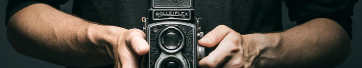 Ornamental image of a person holding an older video camera