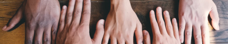 Ornamental image of hands being laid next to each other