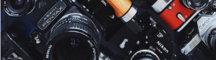 Ornamental image of cameras and lenses.