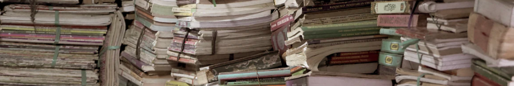 ornamental image of stacks of binded newspapers and magazines