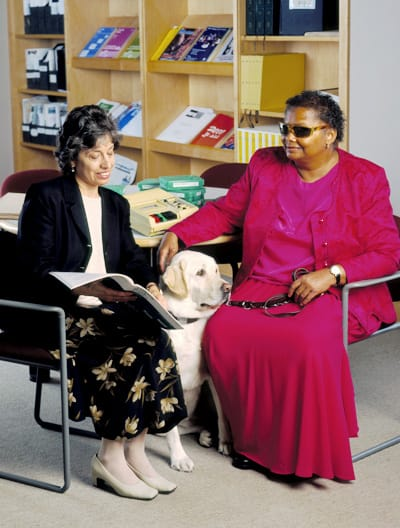 A woman with a service dog.