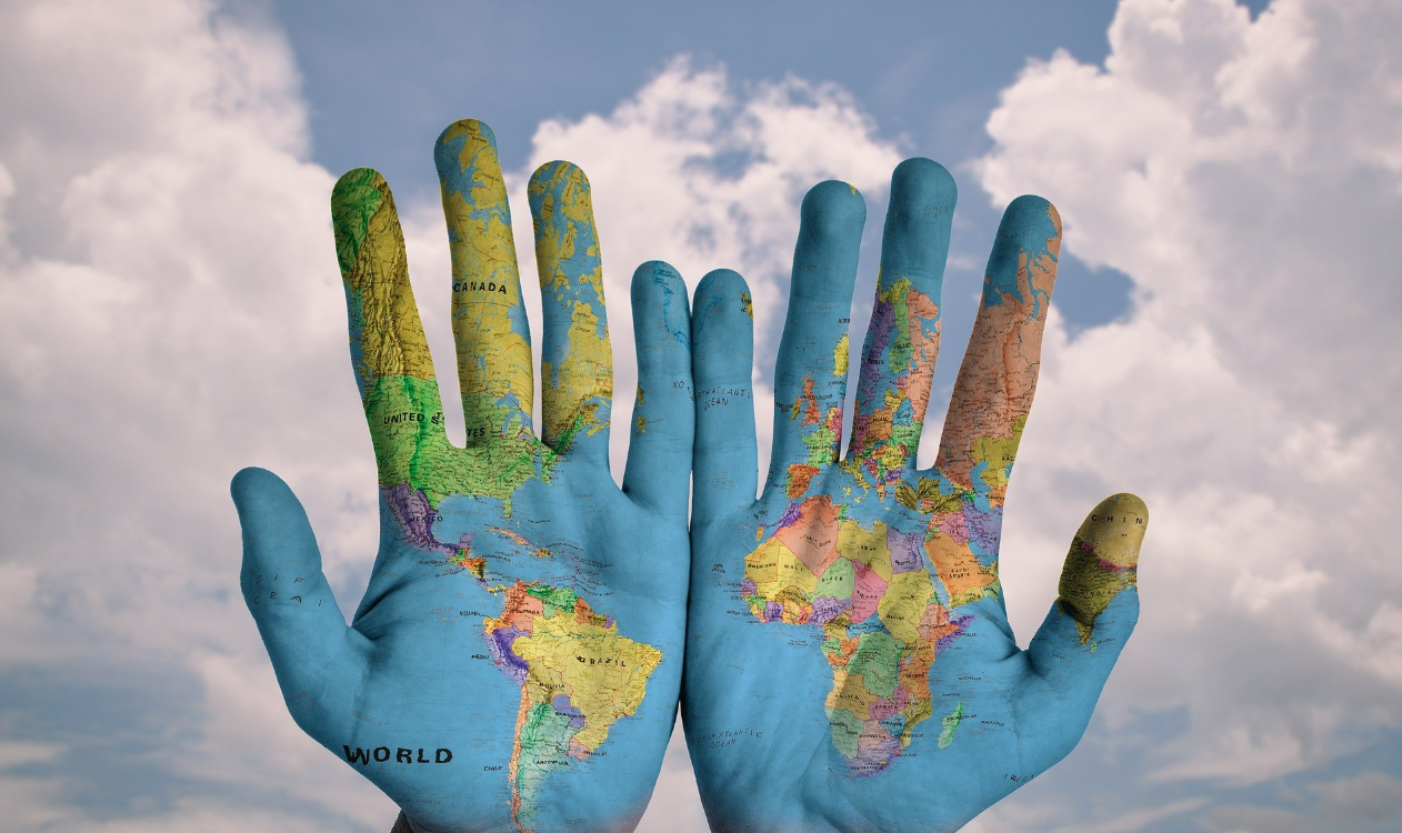 Hands with world painted on them