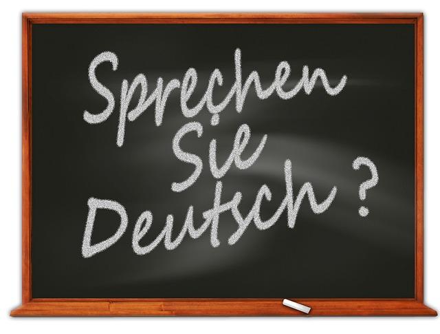 """""""sprechen sie deutsch"""" written on a chalkboard"""