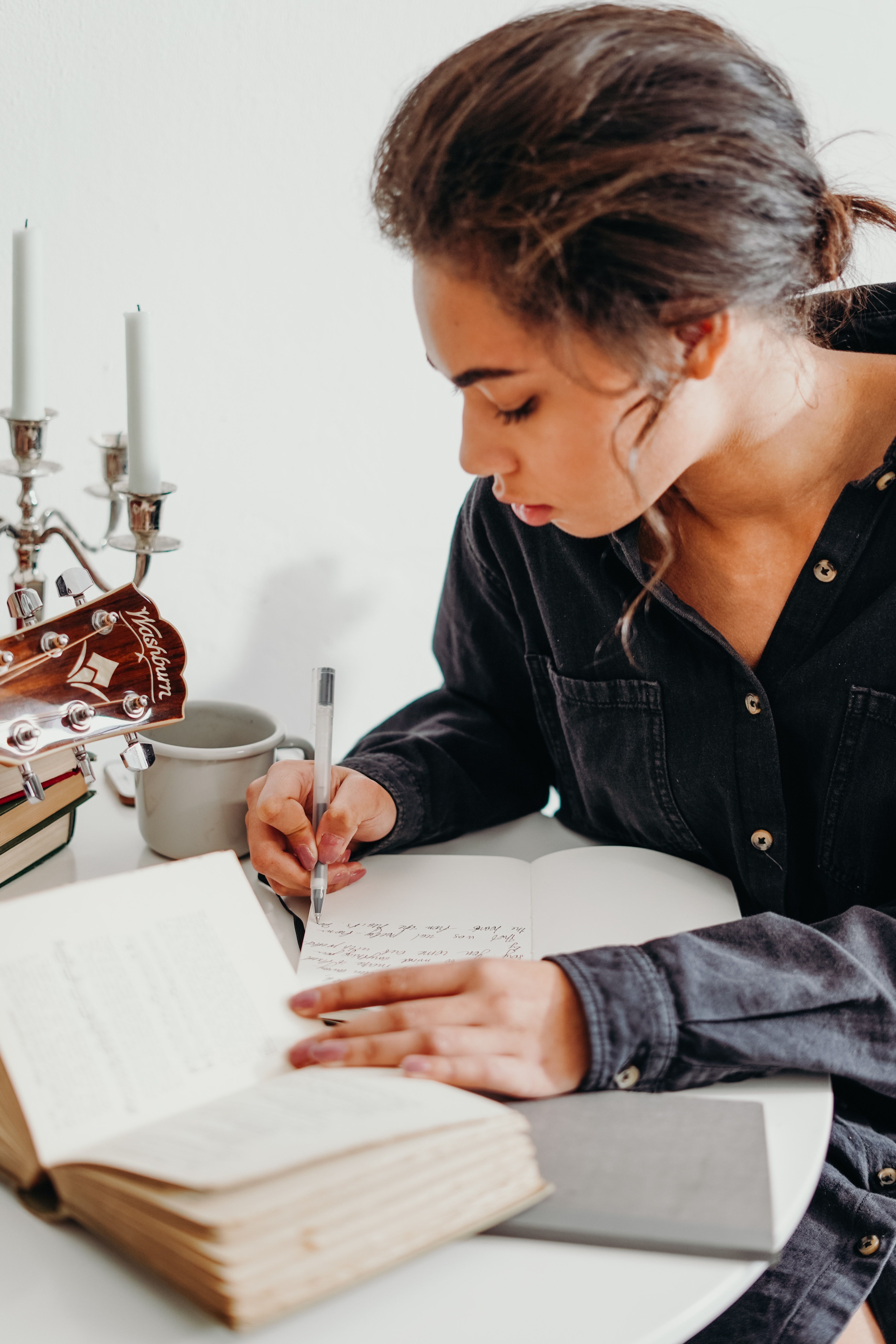 Woman taking notes on a book