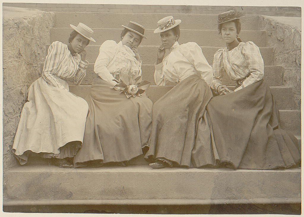 African American women sitting on steps