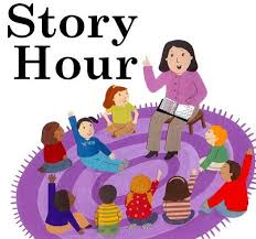 Woman reading to a circle of kids