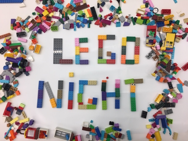 Photo legos on a table arranged to say lego night