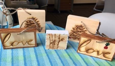 Wood ornaments engraved with trees and the word love