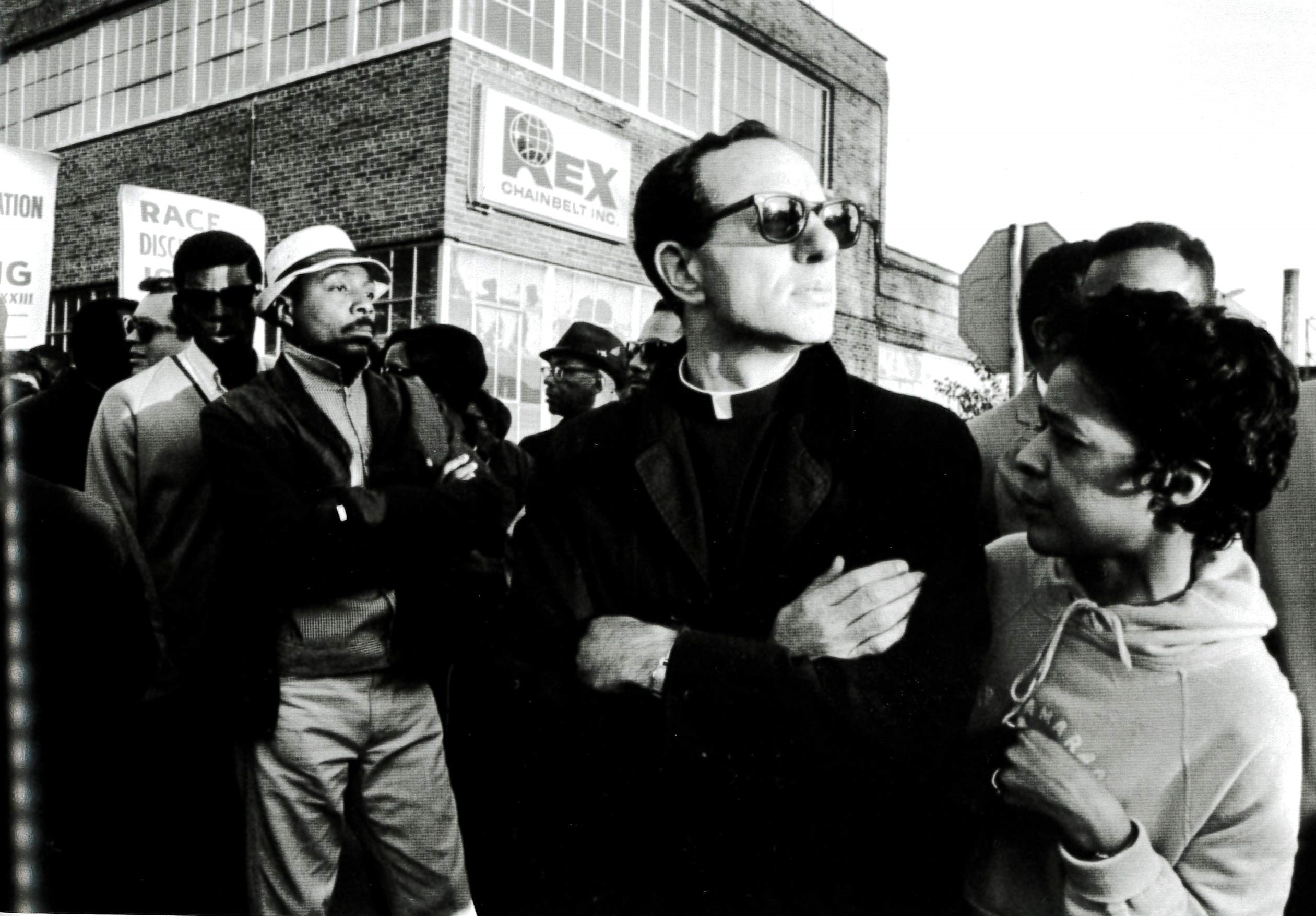 Photo from North of Dixie: Comedian Dick Gregory (in white hat), Milwaukee NAACP Youth Council adviser Father James Groppi (center), and Alderperson Vel Phillips (right) at a march for open housing in Milwaukee, September 1967
