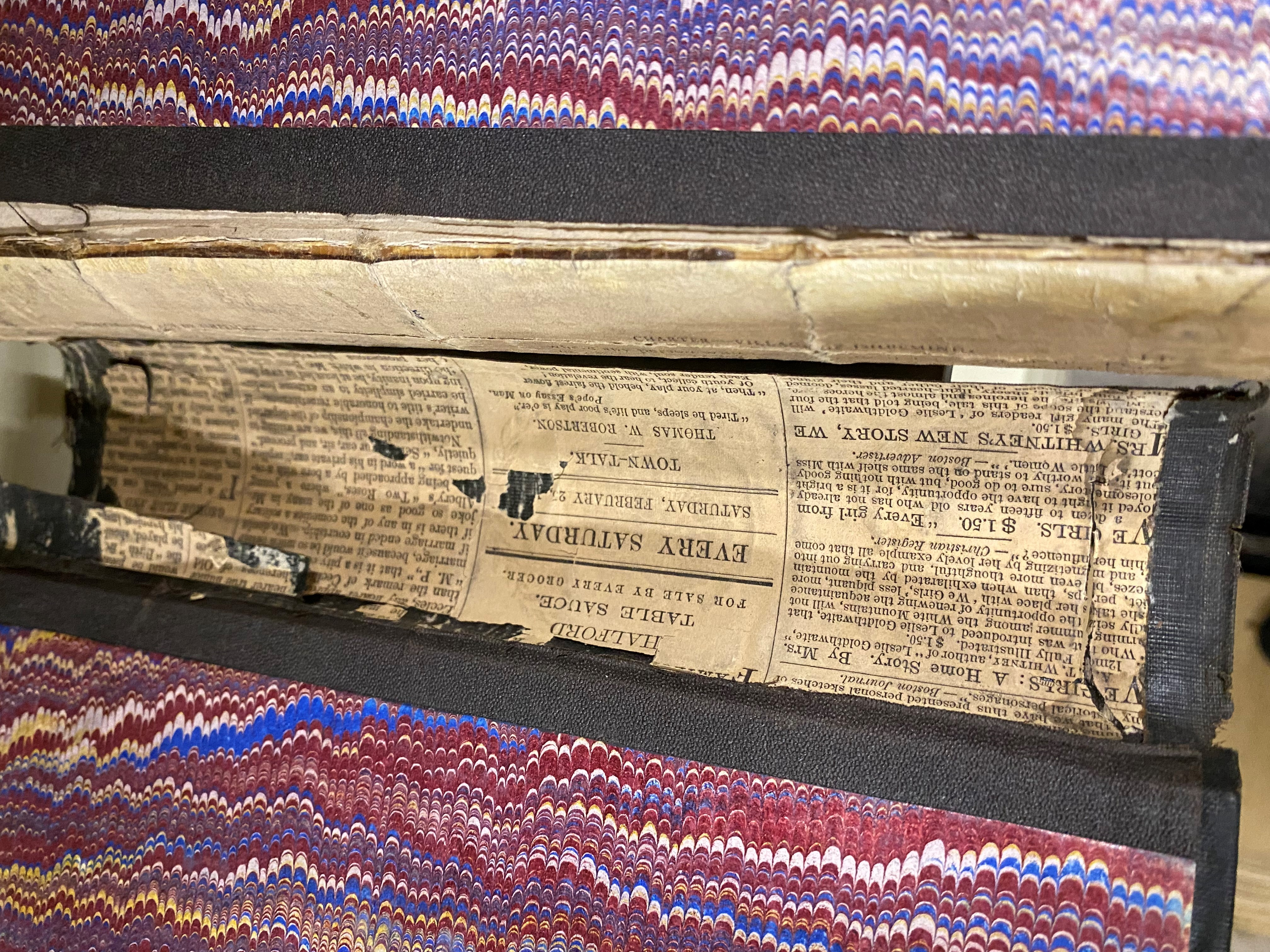 1866 volume showing how old newspaper was used to reinforce the spine