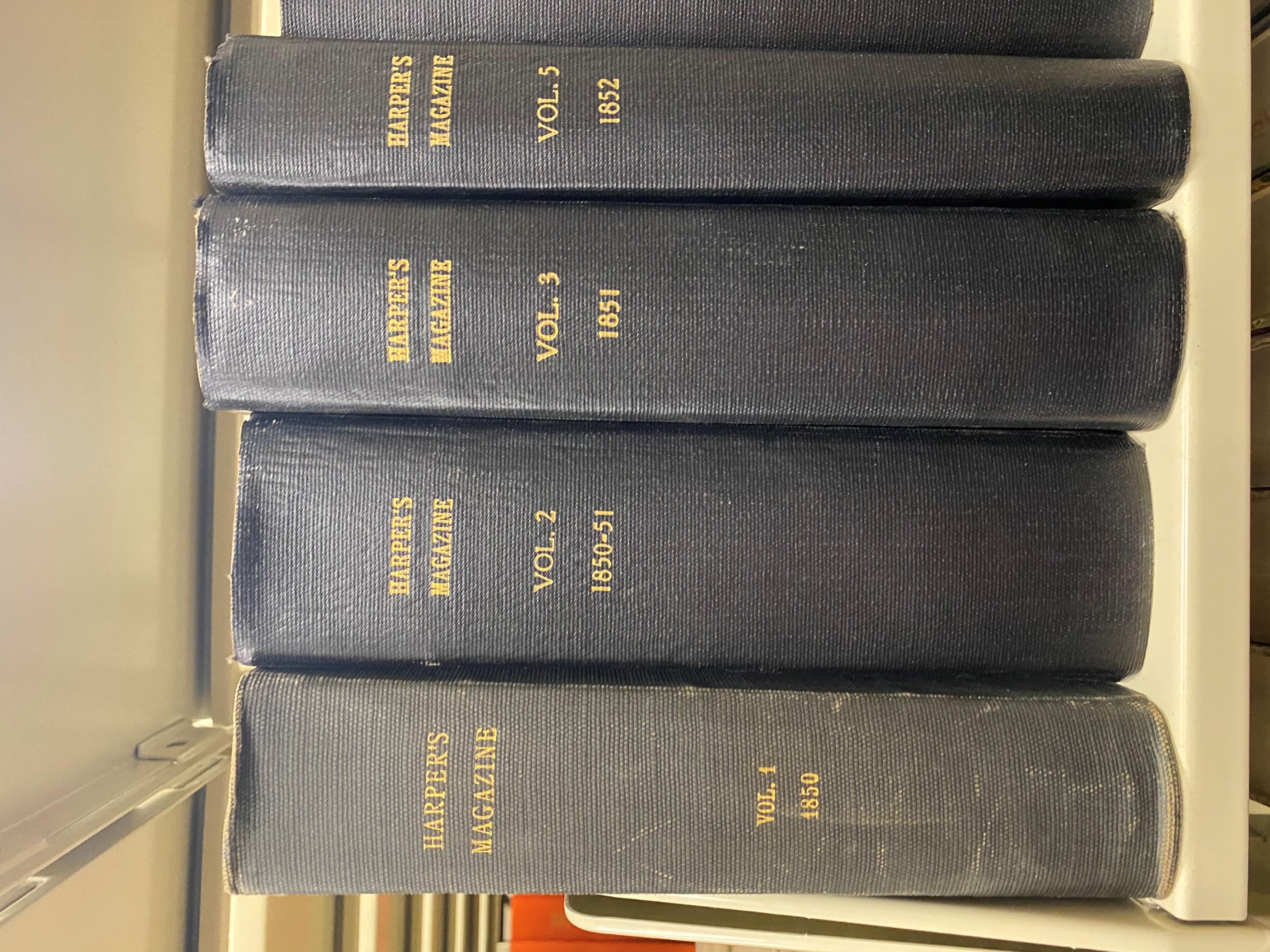 Bound volumes of Harper's magazine sit on shelf