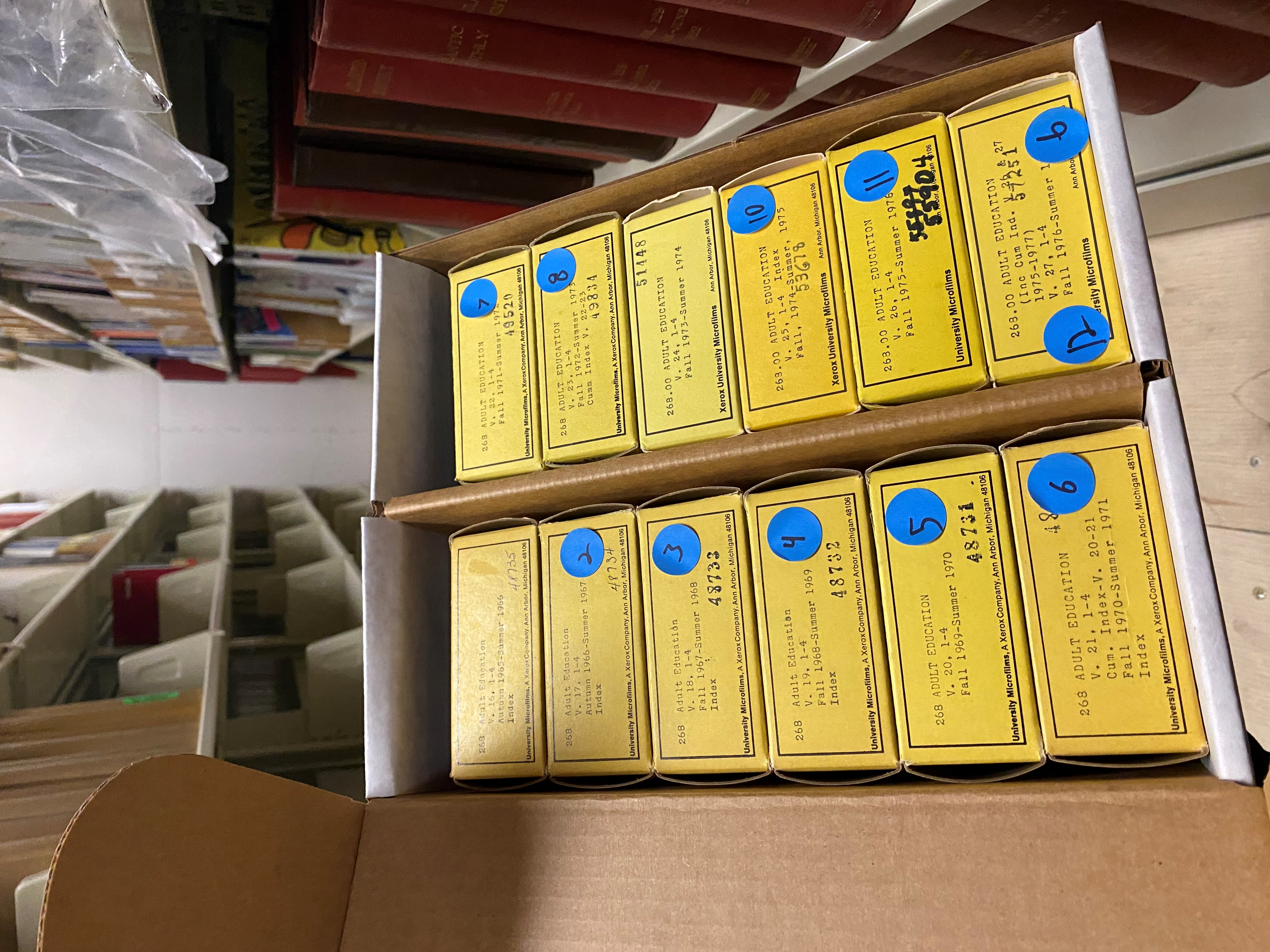 boxes of microfilm for adult education
