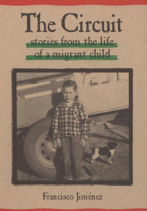 Book cover, photo of a young boy in checked shirt stands in front of large wheel of farm vehicle, small dog next to him.