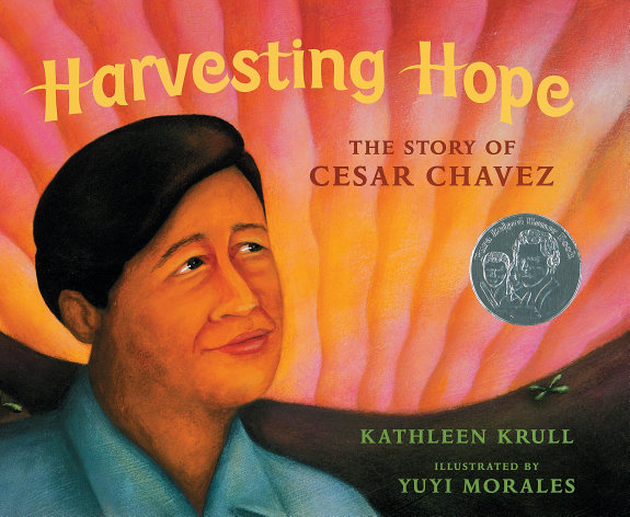 Book Cover, illustrated drawing of Cesar Chavez, green hill and sun rays in sky behind him.