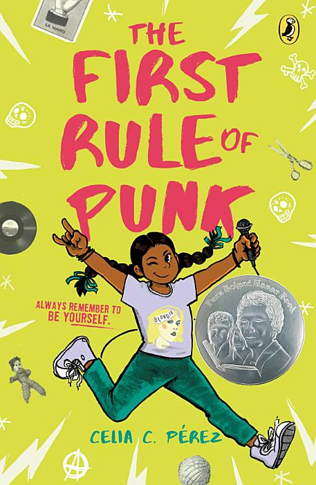 Book cover, girl in pigtails leaps up,arms raised giving rock on salute and holding microphone