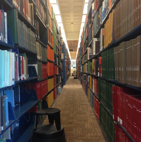 Full, long shelves in BC's O'Neill Library