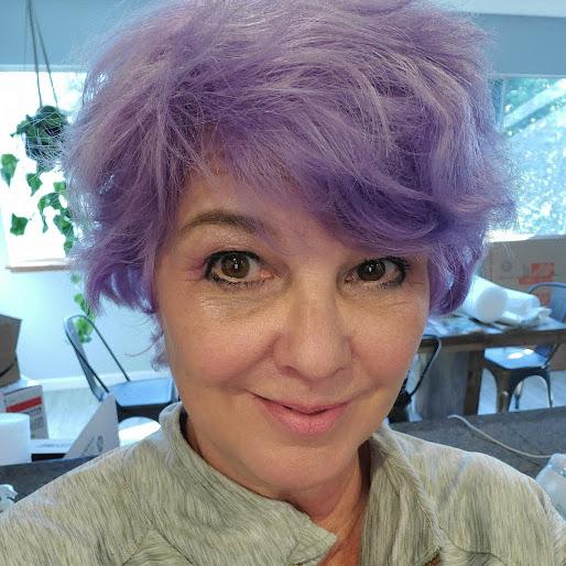 headshot of Andrea