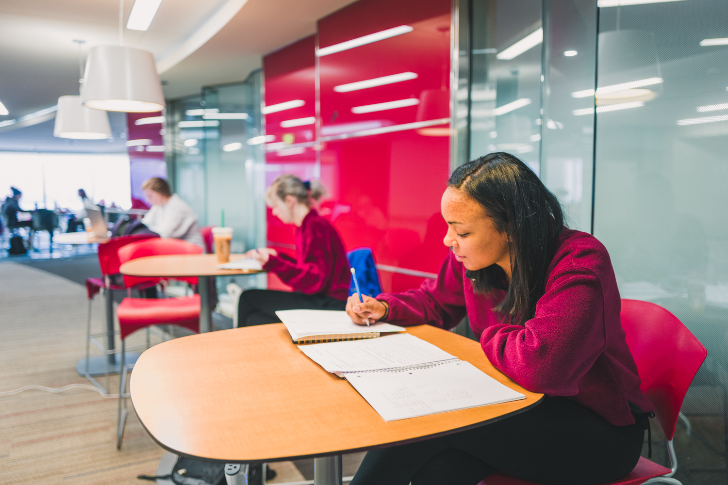 A student studying at the Helmerich Collaborative Learning Center.