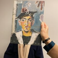 Cover art held in front of a person