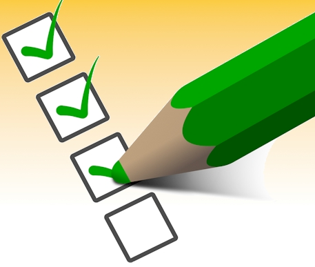 a green pencil marks of items on a checklist