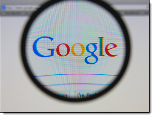 Google logo under magnifying glass