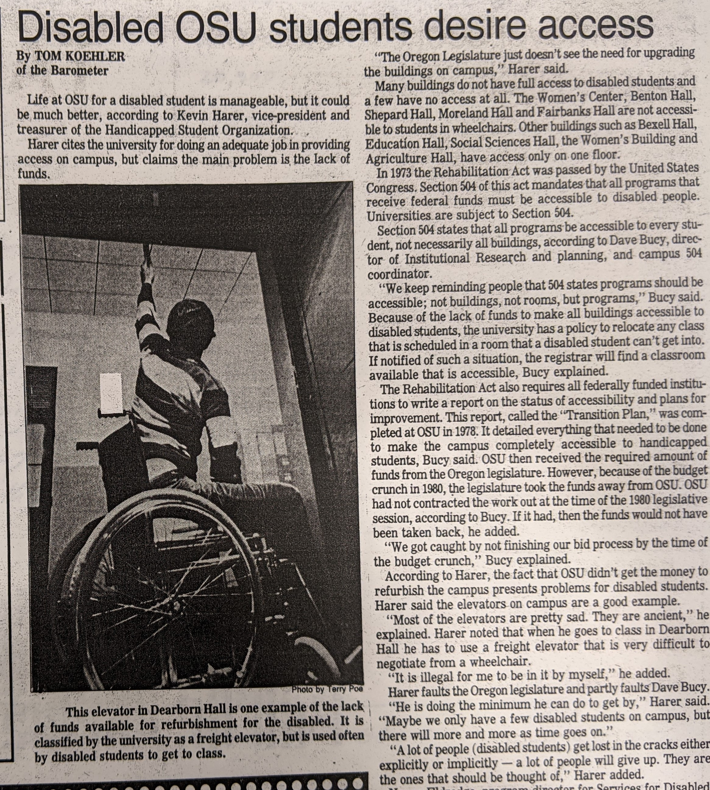 """Photo of a black and white print newspaper article with a headline reading """"Disabled OSU students desire access."""" An accompanying photo shows a student in a wheelchair inside a freight elevator. The photo is taken inside the elevator, behind the student, who is pulling on a rope to lower the elevator door."""
