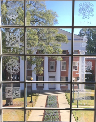 View of Lyceum through a window with printers' marks engraved into it.