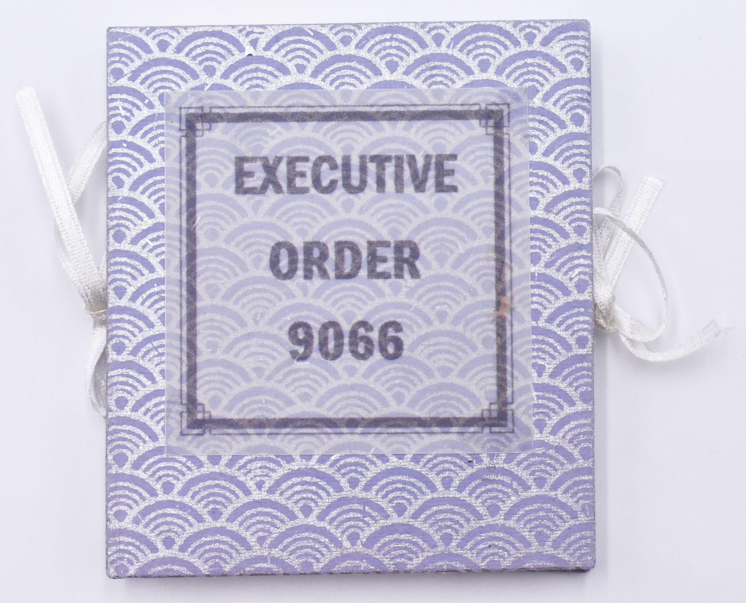 Square cover with repetitive purple & white design.