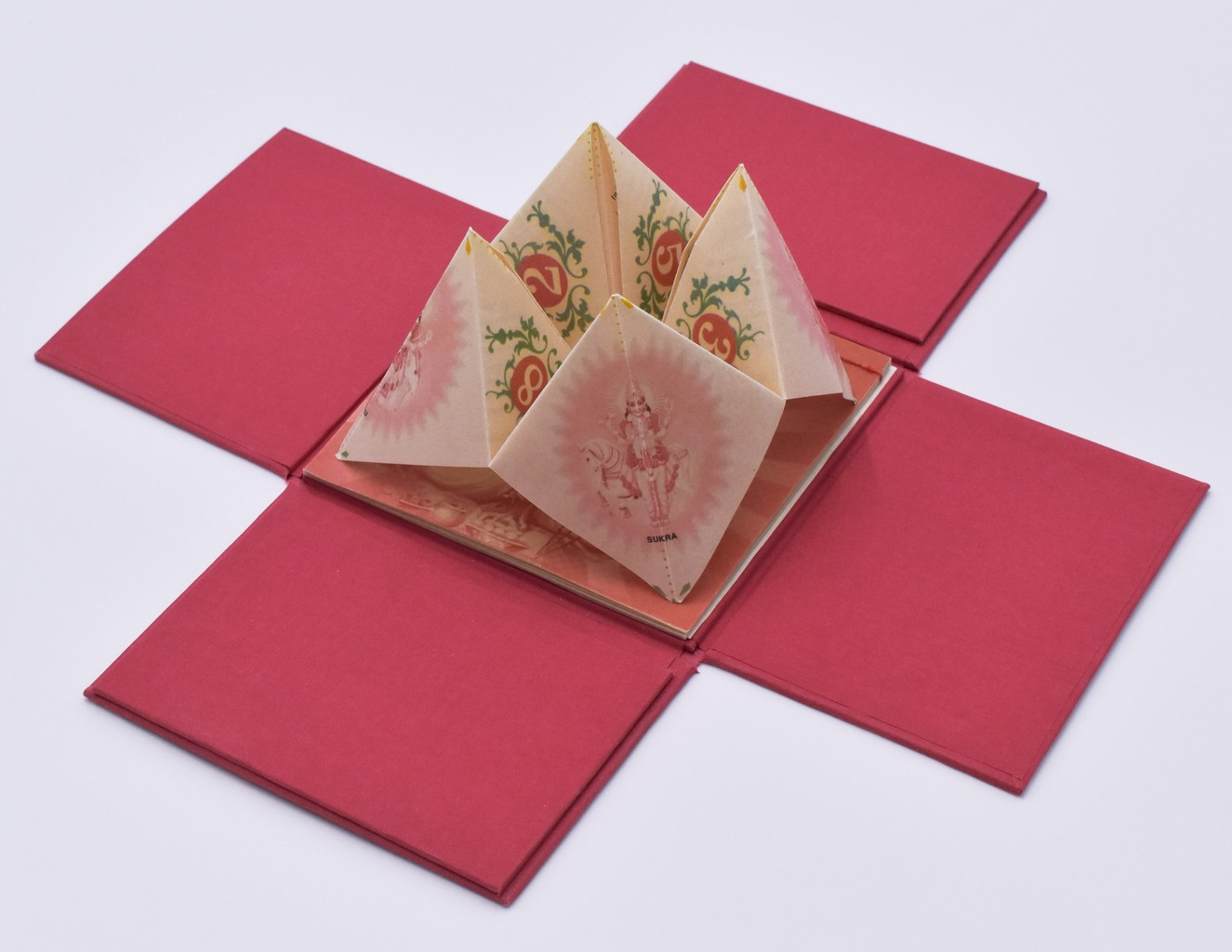 Fortune teller artist's book in open box
