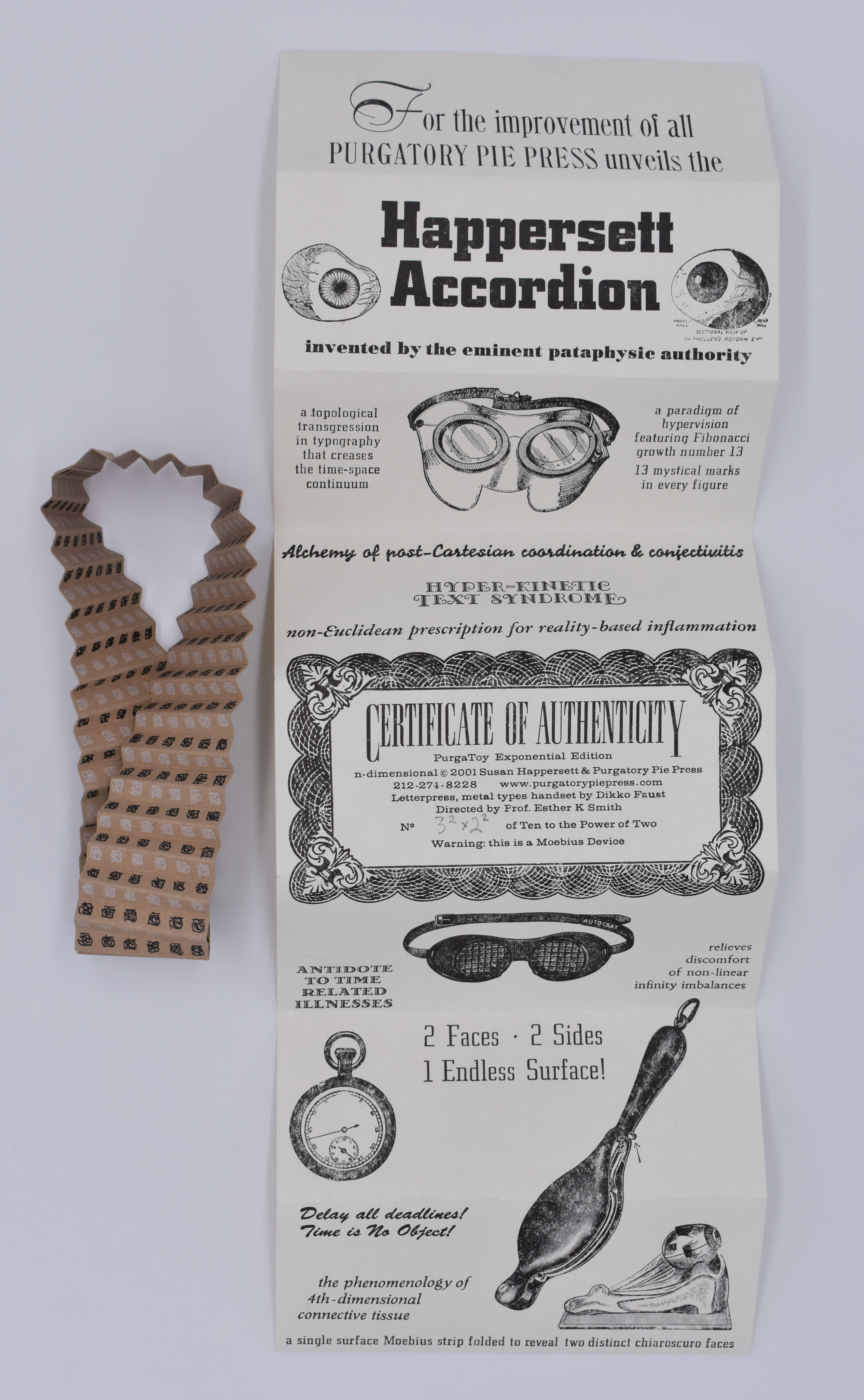 Brown & black mobius strip with accordion folded instructions