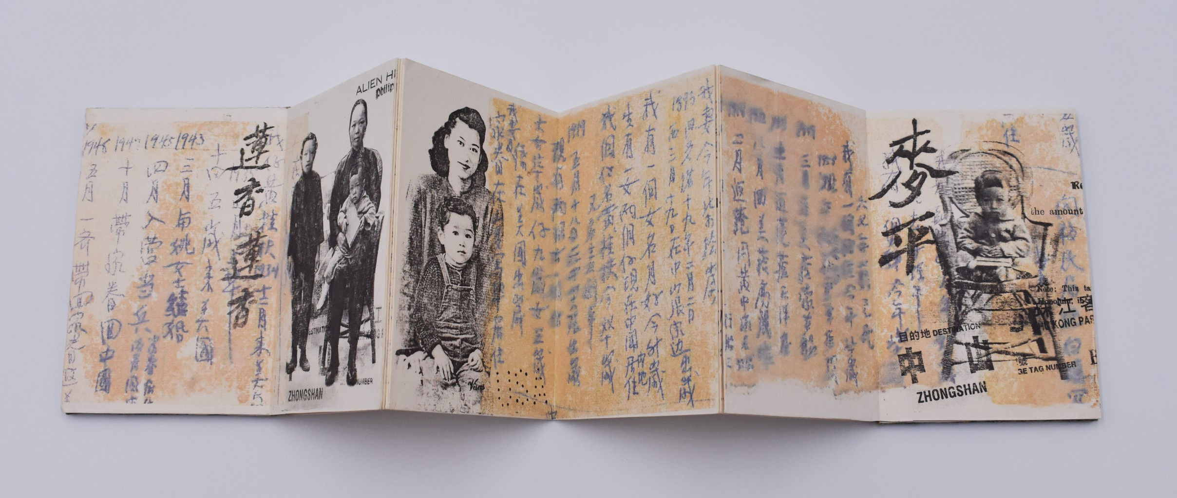 Image of open accordion book with printed image of woman and child