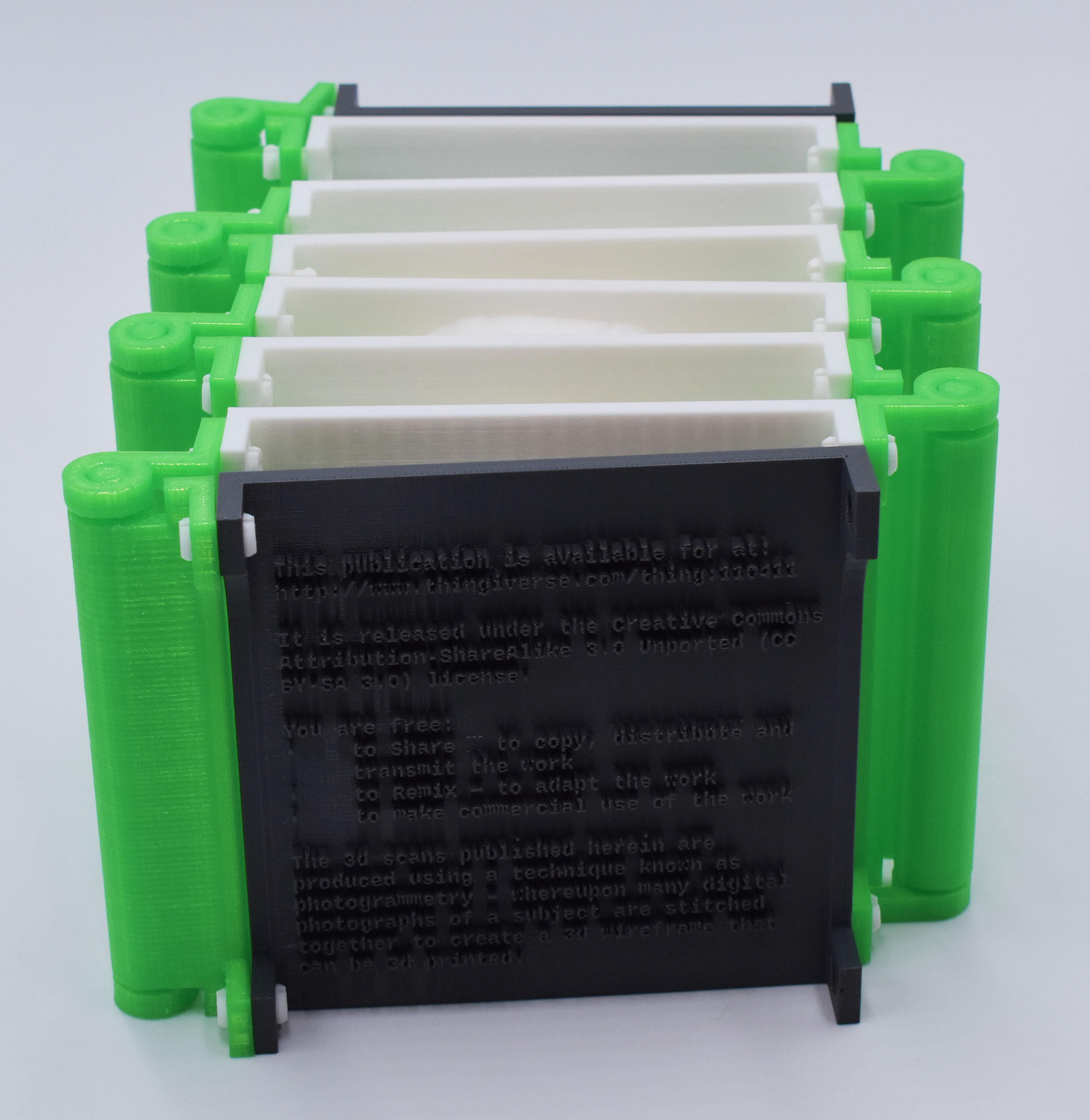 Image of 3D black and green plastic accordion book