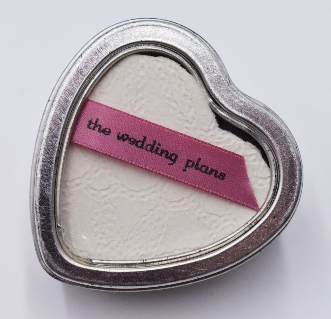 Image of heart shaped accordion book in a heart shaped tin